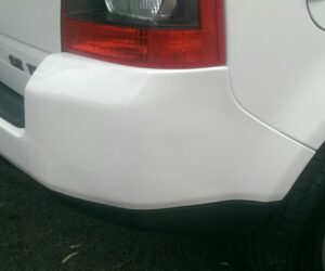 Large bumper dent on a Range rover after repair.